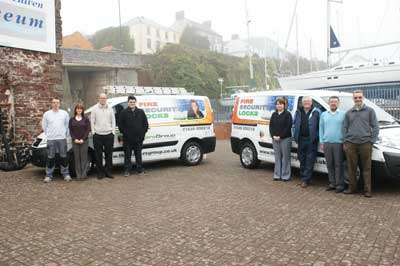 The Walters Group vans and staff